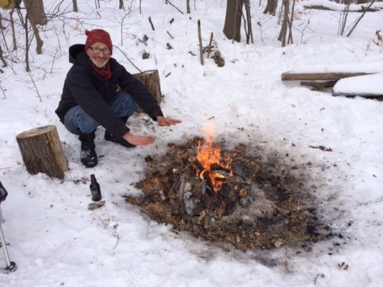 Woodsman (alias husband or forest troll) warming up at campfire on top of Seven Fields.