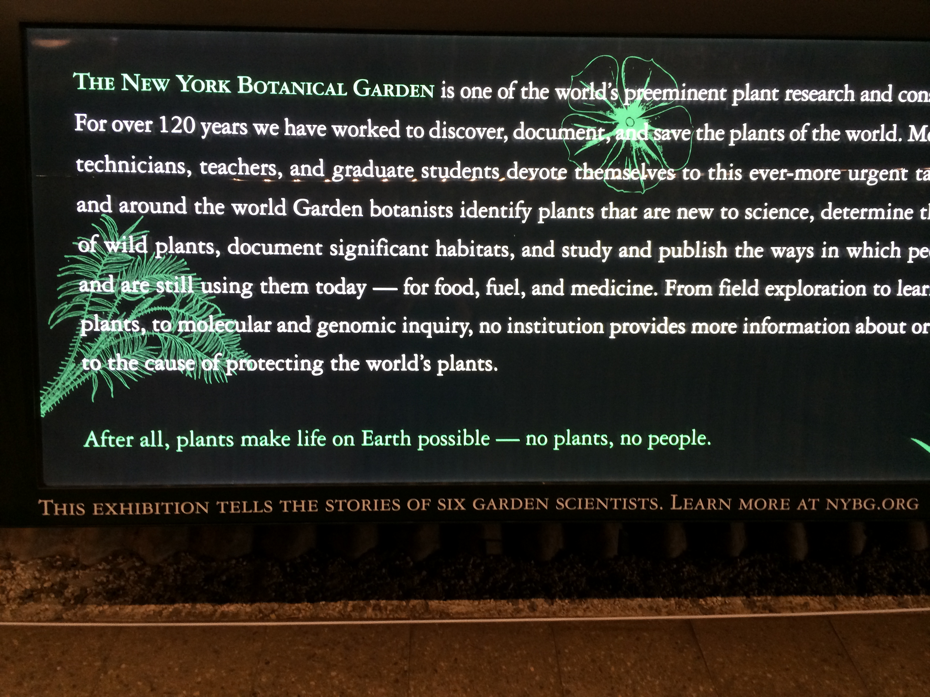 "Informative display in the greenhouse, reminding us ""no plants, no people!"""