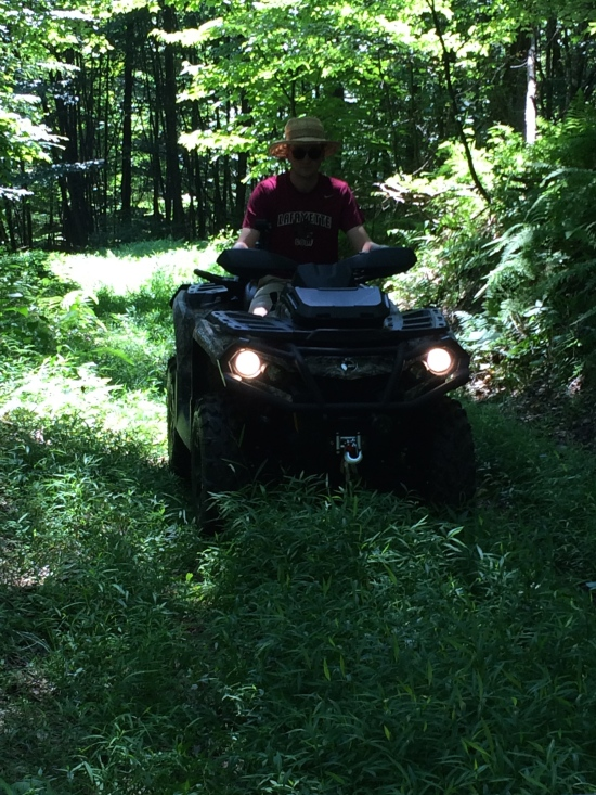 Younger son on ATV.