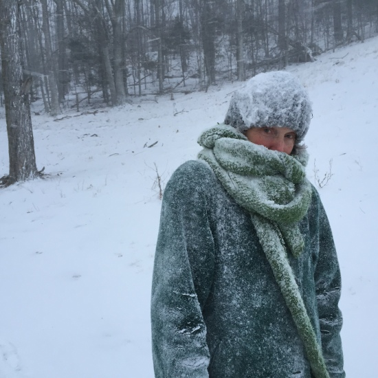 Author poses for husband in blizzard.